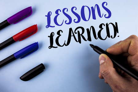 Conceptual hand writing showing Lessons Learned Motivational Call. Business photo text Academic student development optimization written by Man plain background Markers next to it.