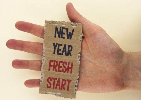 Conceptual hand writing showing New Year Fresh Start. Business photo text Time to follow resolutions reach out dream job written Tear Cardboard Piece the plain background Hand.