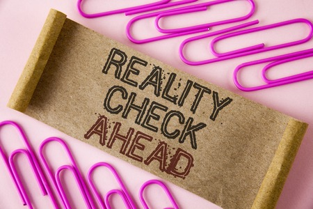 Handwriting text writing Reality Check Ahead. Concept meaning Unveil truth knowing actuality avoid being sceptical written Folded Cardboard paper piece plain background within Paper Pins.