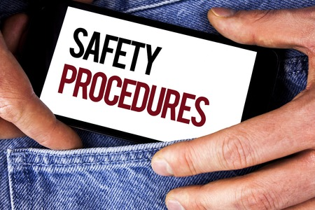 Word writing text Safety Procedures. Business concept for Follow rules and regulations for workplace security written Mobile phone holding by man the Jeans background.