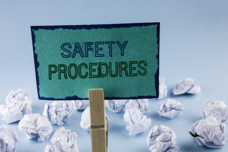 Text sign showing Safety Procedures. Conceptual photo Follow rules and regulations for workplace security written Sticky Note Paper holding by Clip plain background White Paper Balls Imagens