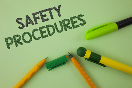 Handwriting text writing Safety Procedures. Concept meaning Follow rules and regulations for workplace security written Plain Green background Pens next to it.