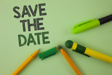 Handwriting text writing Save The Date. Concept meaning Organizing events well make day special by event organizers written Plain Green background Pens next to it.