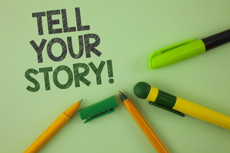 Handwriting text writing Tell Your Story Motivational Call. Concept meaning Share your experience motivate world written Plain Green background Pens next to it.