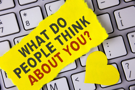 Word writing text What Do People Think About You Question. Business concept for This is how others judge you written tear Sticky Note Paper placed the Laptop Yellow Heart next to it. Stock Photo
