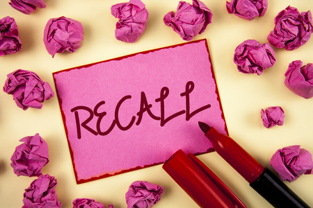 Word writing text Recall. Business concept for Bring back to memory Ordering the return of a person or product written Pink Sticky Note Paper plain background Paper Balls and Marker.