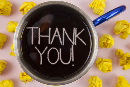 Writing note showing  Thank You Motivational Call. Business photo showcasing Appreciation greeting Acknowledgment Gratitude written Black Tea in Cup within Paper Balls plain background. Stock Photo