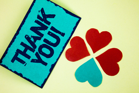 Word writing text Thank You Motivational Call. Business concept for Appreciation greeting Acknowledgment Gratitude written Sticky Note paper plain background Paper Love Hearts next to it.