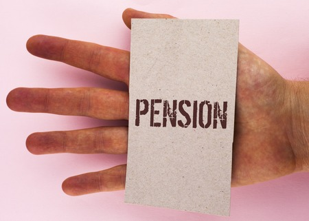 Text sign showing Pension. Conceptual photo Income seniors earn after retirement Saves for elderly years written Cardboard Piece placed Hand the plain background.