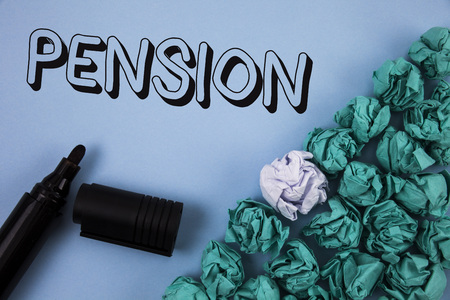 Handwriting text Pension. Concept meaning Income seniors earn after retirement Saves for elderly years written Plain Blue background Crumpled Paper Balls and Marker next to it. Reklamní fotografie