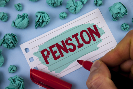 Text sign showing Pension. Conceptual photo Income seniors earn after retirement Saves for elderly years written by Man Painted Notepad Paper holding Marker plain background Paper Balls.