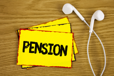 Word writing text Pension. Business concept for Income seniors earn after retirement Saves for elderly years written Yellow Sticky Note Paper wooden background Handsfree next to it. Reklamní fotografie
