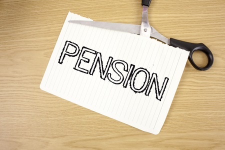 Conceptual hand writing showing Pension. Business photo text Income seniors earn after retirement Saves for elderly years written Tear Notebook Paper wooden background Scissor.