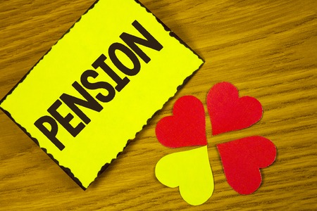 Conceptual hand writing showing Pension. Business photo text Income seniors earn after retirement Saves for elderly years written Sticky note paper wooden background Paper Love Hearts