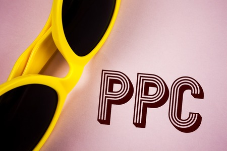 Text sign showing Ppc. Conceptual photo Pay Per Click Advertising Strategies Direct Traffic to Websites written Plain Pink background Sunglasses next to it.