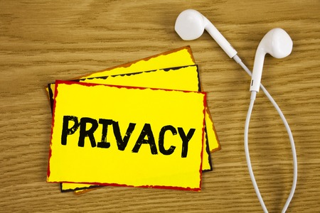 Word writing text Privacy. Business concept for Right to keep personal matters and information as a secret written Yellow Sticky Note Paper wooden background Handsfree next to it.