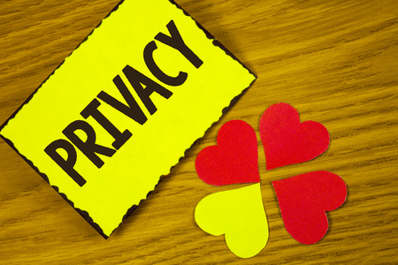 Conceptual hand writing showing Privacy. Business photo text Right to keep personal matters and information as a secret written Sticky note paper wooden background Paper Love Hearts