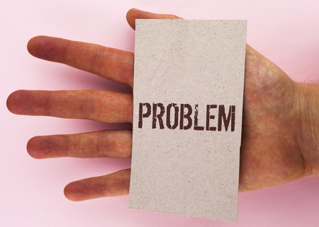 Text sign showing Problem. Conceptual photo Trouble that need to be solved Difficult Situation Complication written Cardboard Piece placed Hand the plain background.