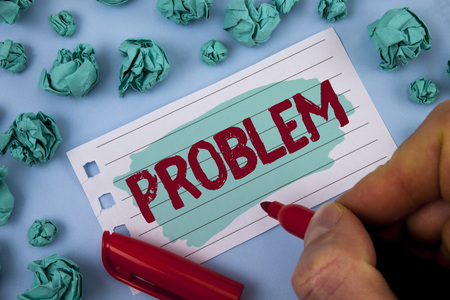 Text sign showing Problem. Conceptual photo Trouble that need to be solved Difficult Situation Complication written by Man Painted Notepad Paper holding Marker plain background Paper Balls.
