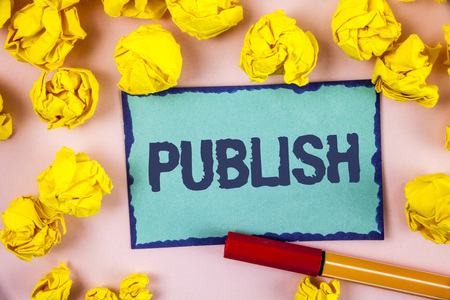 Writing note showing  Publish. Business photo showcasing Make information available to people Issue a written product written Sticky note paper within paper balls plain background Pen