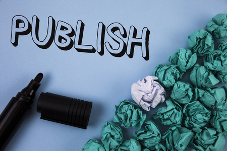 Handwriting text Publish. Concept meaning Make information available to people Issue a written product written Plain Blue background Crumpled Paper Balls and Marker next to it. Stock Photo