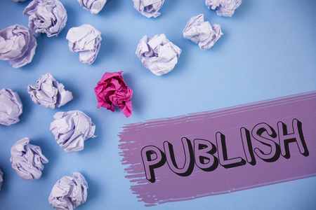 Word writing text Publish. Business concept for Make information available to people Issue a written product written the Painted background Crumpled Paper Balls next to it. Stock Photo