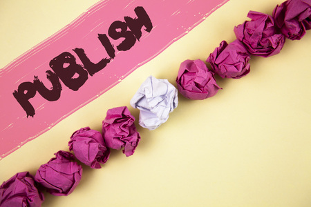 Handwriting text writing Publish. Concept meaning Make information available to people Issue a written product written Painted background Crumpled Paper Balls Line next to it. Stock Photo