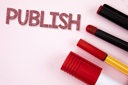 Conceptual hand writing showing Publish. Business photo text Make information available to people Issue a written product written plain background Pens Pencil and Marker next to it. Stock Photo