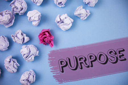 Word writing text Purpose. Business concept for Reason for doing something Desired Goal Target Planned Achievement written the Painted background Crumpled Paper Balls next to it.