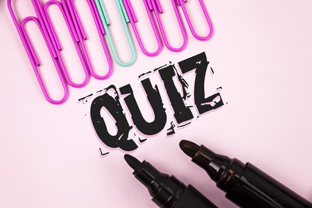 Handwriting text Quiz. Concept meaning Short Tests Evaluation Examination to quantify your knowledge written Plain Pink background Paper Pins and Markers next to it.