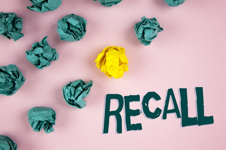 Word writing text Recall. Business concept for Bring back to memory Ordering the return of a person or product written plain Pink background Crumpled Paper Balls next to it. Stock Photo