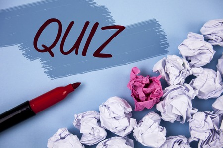 Text sign showing Quiz. Conceptual photo Short Tests Evaluation Examination to quantify your knowledge written Painted background Crumpled Paper Balls and Marker next to it.