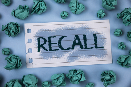 Text sign showing Recall. Conceptual photo Bring back to memory Ordering the return of a person or product written Notepad Paper within Green Paper Balls Plain Blue background.