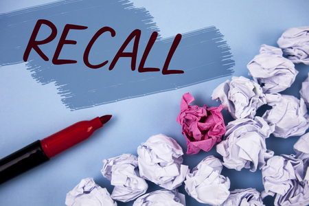 Text sign showing Recall. Conceptual photo Bring back to memory Ordering the return of a person or product written Painted background Crumpled Paper Balls and Marker next to it.