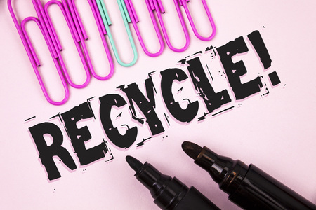 Handwriting text Recycle Motivational Call. Concept meaning Convderting waste into reusable material written Plain Pink background Paper Pins and Markers next to it. Stock Photo