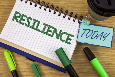 Writing note showing  Resilience. Business photo showcasing Capacity to recover quickly from difficulties Persistence written Noteoad wooden background Today Cup Pen Marker next to it