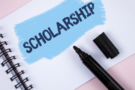 Text sign showing Scholarship. Conceptual photo Grant or Payment made to support education Academic Study written Painted Notepad plain Pink background Marker next to it.