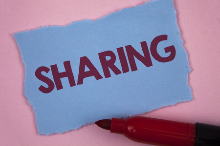 Writing note showing  Sharing. Business photo showcasing To Share Give a portion of something to another Possess in common written Tear Blue Sticky note paper Plain Pink background Marker.