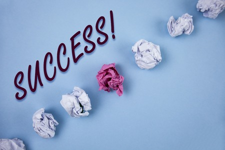 Handwriting text writing Success Motivational Call. Concept meaning Achievement Accomplishment of some purpose written Plain Blue background Crumpled Paper Balls next to it. 免版税图像 - 99480309
