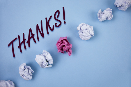 Handwriting text writing Thanks Motivational Call. Concept meaning Appreciation greeting Acknowledgment Gratitude written Plain Blue background Crumpled Paper Balls next to it. Stock Photo