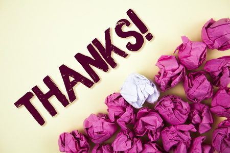 Text sign showing Thanks Motivational Call. Conceptual photo Appreciation greeting Acknowledgment Gratitude written Plain background Crumpled Paper Balls next to it.
