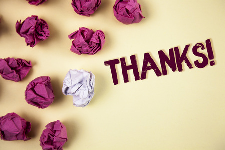 Writing note showing  Thanks Motivational Call. Business photo showcasing Appreciation greeting Acknowledgment Gratitude written Plain background Crumpled Paper Balls next to it.