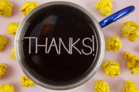 Writing note showing  Thanks Motivational Call. Business photo showcasing Appreciation greeting Acknowledgment Gratitude written Black Tea in Cup within Paper Balls plain background.