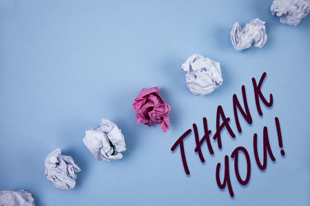 Handwriting text writing Thank You Motivational Call. Concept meaning Appreciation greeting Acknowledgment Gratitude written Plain Blue background Crumpled Paper Balls next to it.