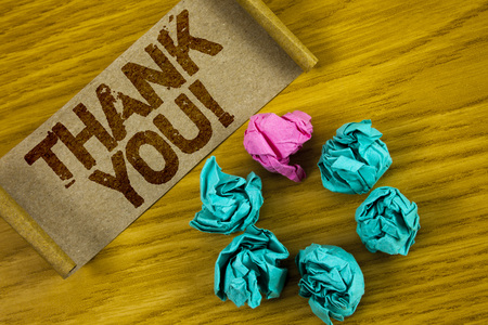 Handwriting text writing Thank You Motivational Call. Concept meaning Appreciation greeting Acknowledgment Gratitude written Folded Cardboard Paper piece wooden background Paper Balls.