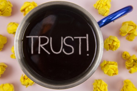 Writing note showing  Trust Motivational Call. Business photo showcasing Belief in the Reliability Truth Ability Confidence written Black Tea in Cup within Paper Balls plain background.