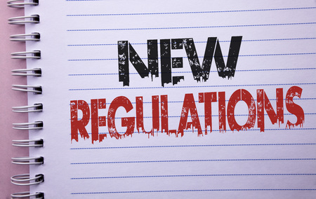 Word writing text New Regulations. Business concept for Change of Laws Rules Corporate Standards Specifications written Notebook Book the plain background.