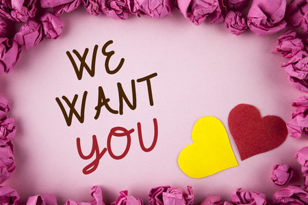 Word writing text We Want You. Business concept for Employee Help Wanted Workers Recruitment Headhunting Employment written plain background within Pink Paper Balls Hearts next to it. Stock Photo
