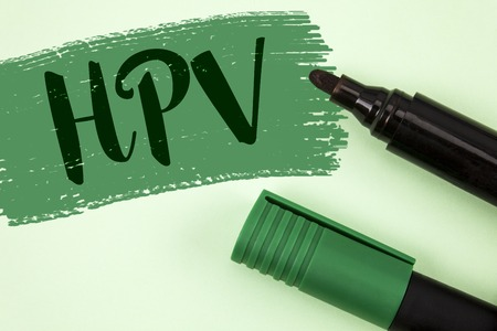 Text sign showing Hpv. Conceptual photo Human Papillomavirus Infection Sexually Transmitted Disease Illness written Painted Green background Markers next to it. Stock Photo