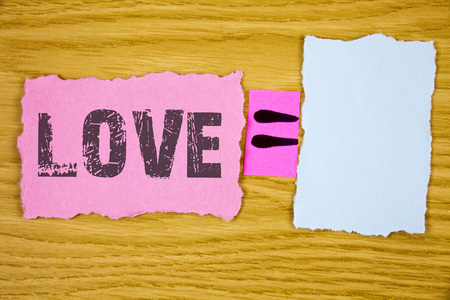 Writing note showing  Love. Business photo showcasing Intense feeling Deep affection Romantic Sexual attachment Relationship written Tear Sticky note paper wooden background Equation Space. Stock Photo